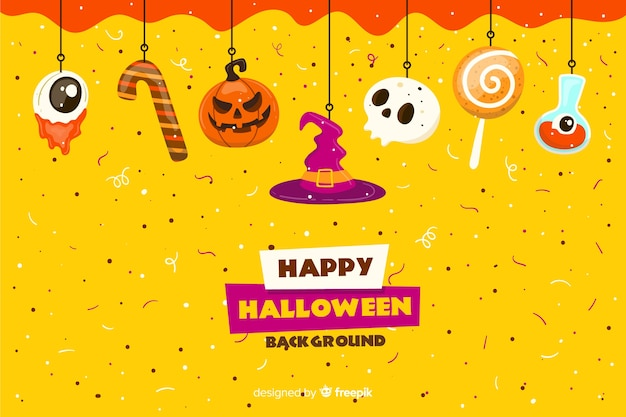 Sweets on flat halloween confetti background Free Vector