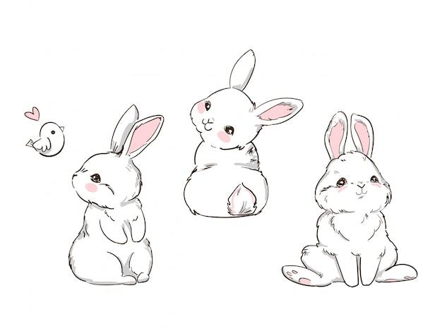白い背景で隔離の手描きかわいいバニー。ウサギのプリントデザイン。子供たちはtシャツに印刷します。 Premiumベクター