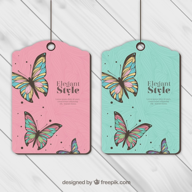 Tags with butterflies Free Vector