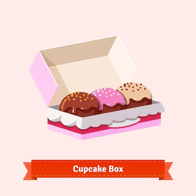 Tasty looking cupcakes in the cardbox Free Vector