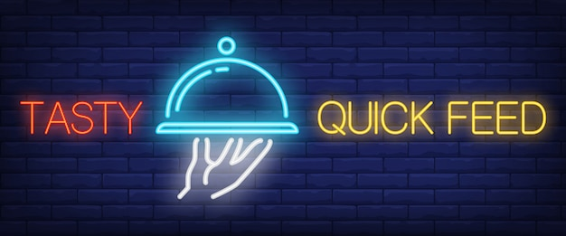 Tasty quick feed sign in neon style Free Vector