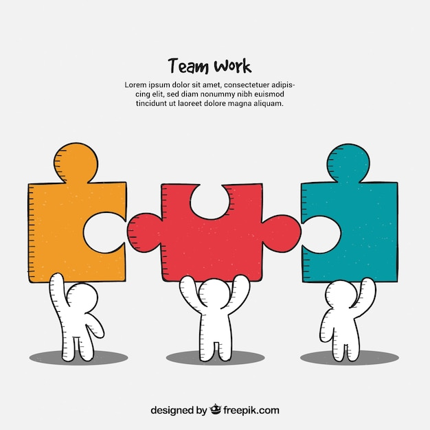 Teamwork concept with persons holding jigsaw\ pieces
