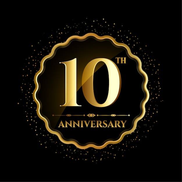 Ten anniversary in golden frame with sparks Free Vector