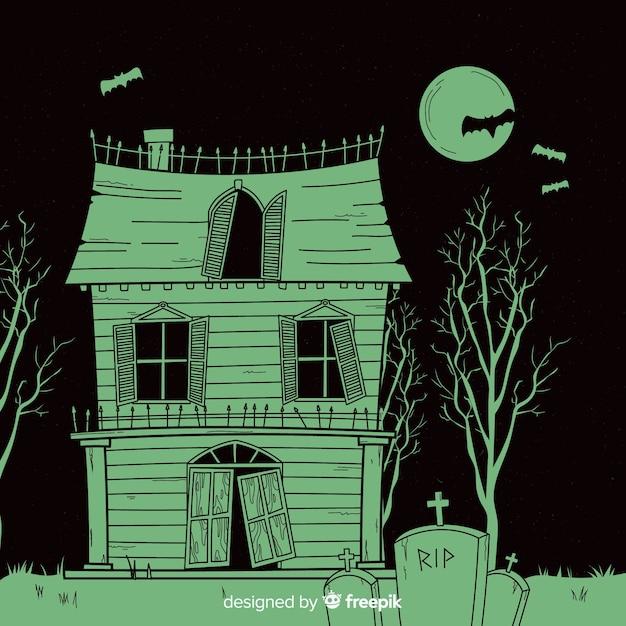 Terrific hand drawn halloween haunted house Free Vector