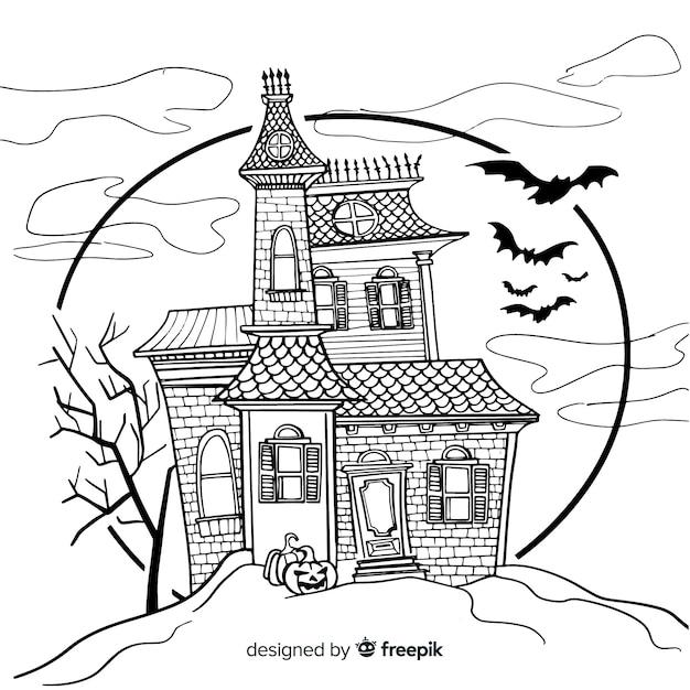 Terrific hand drawn haunted house Free Vector