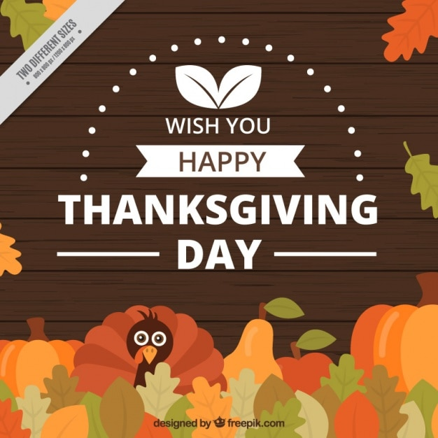 Thanksgiving day background with a turkey and leaves Free Vector