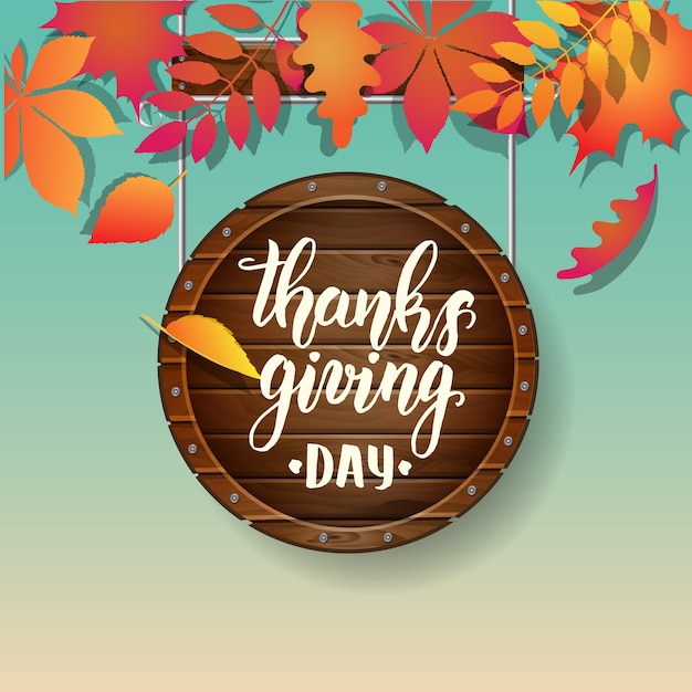 Thanksgiving day lettering calligraphy phrase. autumn background with leaves Premium Vector