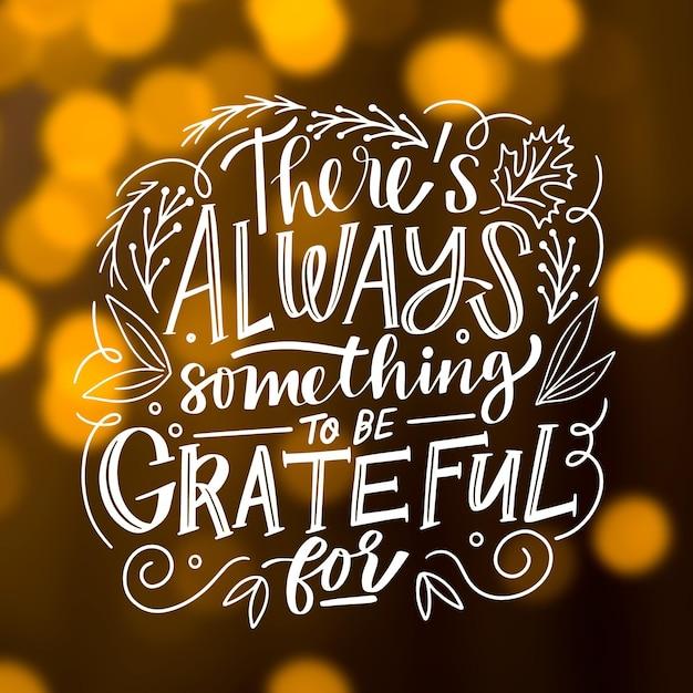 Надпись благодарения на размытом фоне Бесплатные векторы