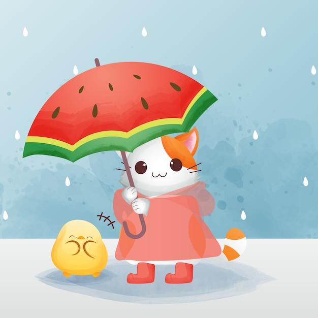 かわいい猫のキャラクターは赤いレインコートとブーツを履き、ひよこ水彩風の傘をさしています。 Premiumベクター