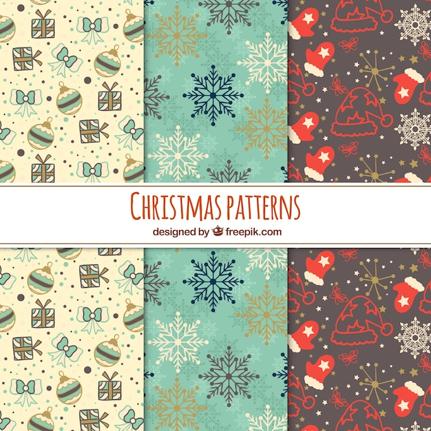 Three christmas patterns in soft colours Free Vector