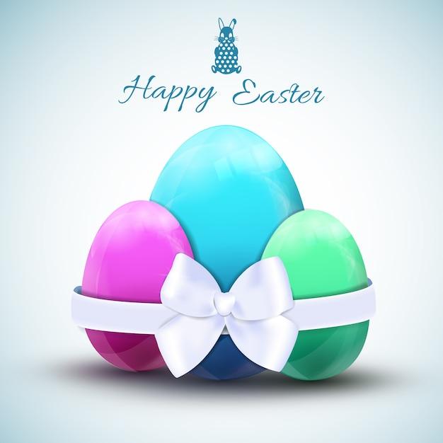 Tre uova di pasqua colorate con fiocco bianco illustrazione realistica di vettore Vettore gratuito