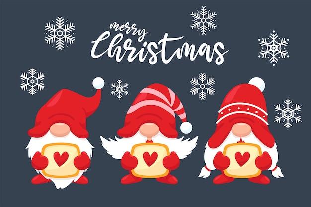 冬の雪の背景にハートと3つのかわいいクリスマスのノーム Premiumベクター