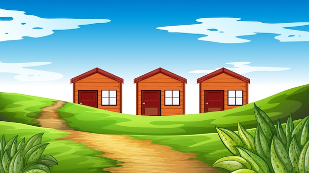 Three houses on the field Free Vector