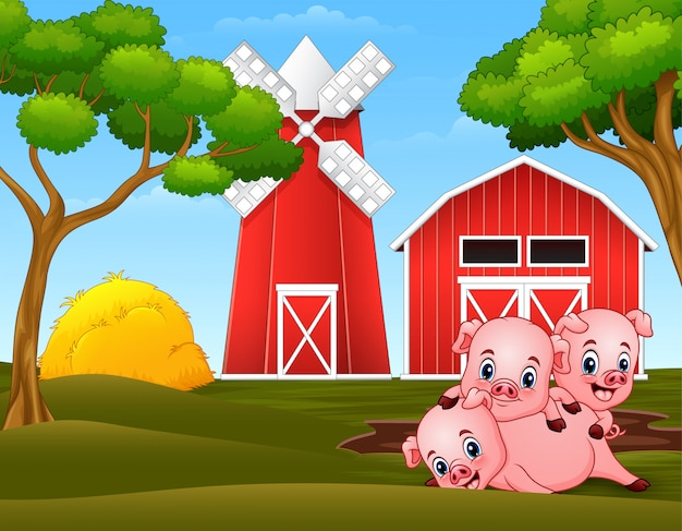 Three little pigs are playing at the farm Premium Vector