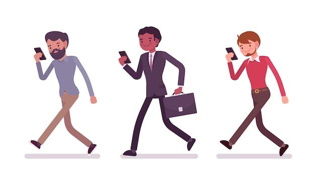 Three men are walking holding a smartphone Premium Vector