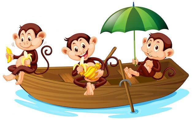 Три обезьяны едят банан на лодке Бесплатные векторы
