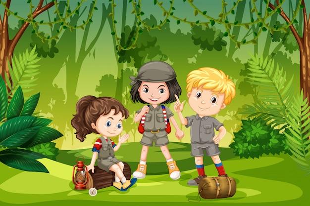 Three scout kids in the jungle Premium Vector