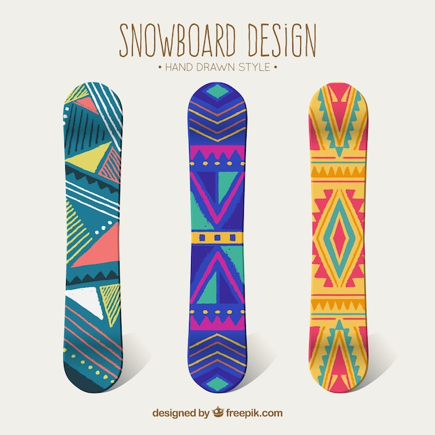 Three snowboards with ethnic designs