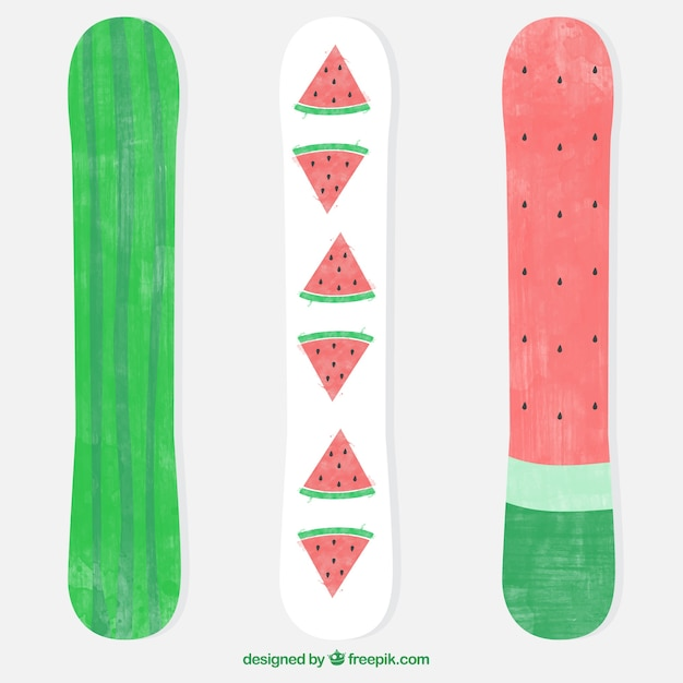 Three snowboards with watercolor watermelon\ design