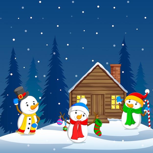 Three snowman and winter background Premium Vector