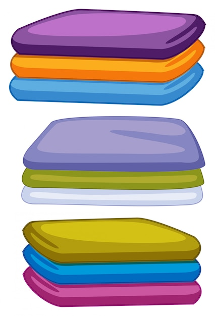 Three stacks of towels in different color Free Vector