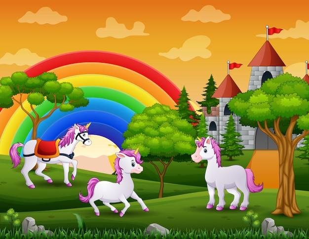 Three of unicorn outside of a castle Premium Vector