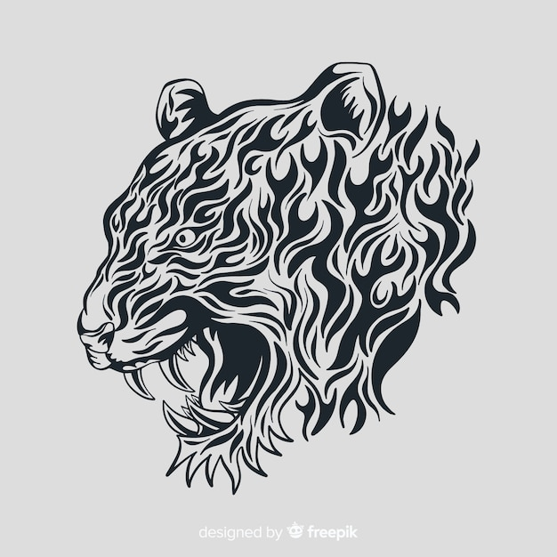 Tiger face with tribal style Free Vector