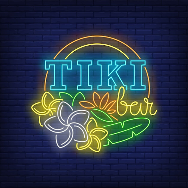 Tiki bar neon text with flowers Free Vector