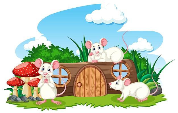 Деревянный дом с тремя мышками мультяшном стиле на белом фоне Бесплатные векторы