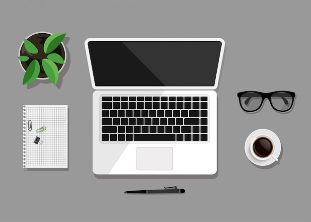 Top view of business workplace on grey Premium Vector