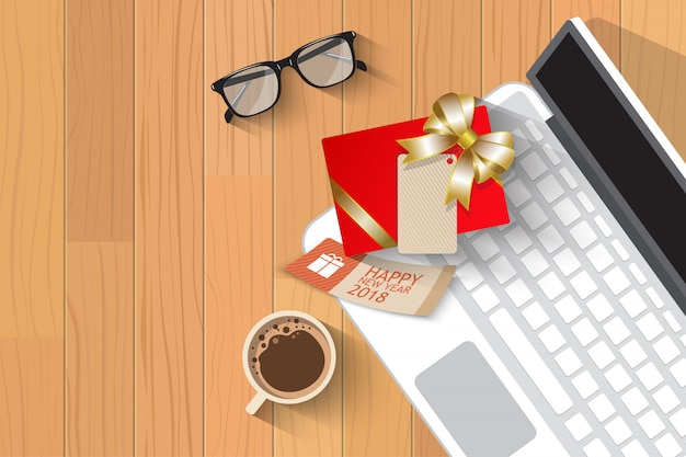Top view christmas gift over laptop Premium Vector