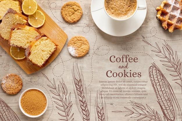 Vista dall'alto deliziosi dolci con una tazza di caffè Vettore gratuito