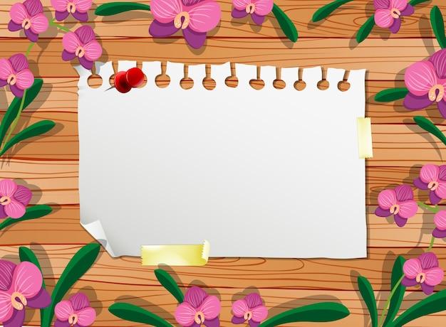 葉とピンクの蘭の要素とテーブルの上の白紙の上面図 無料ベクター