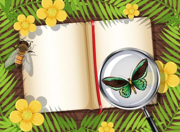 Вид сверху деревянного стола с пустой страницей книги и элементом насекомых и листьев Premium векторы