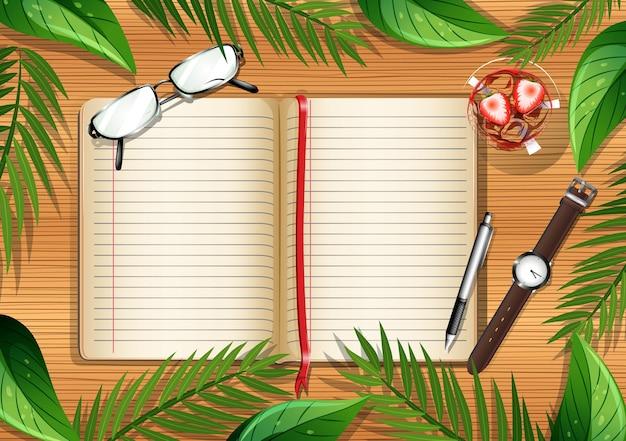 本とオフィスオブジェクトと葉の要素の空白のページと木製のテーブルの上面図 無料ベクター