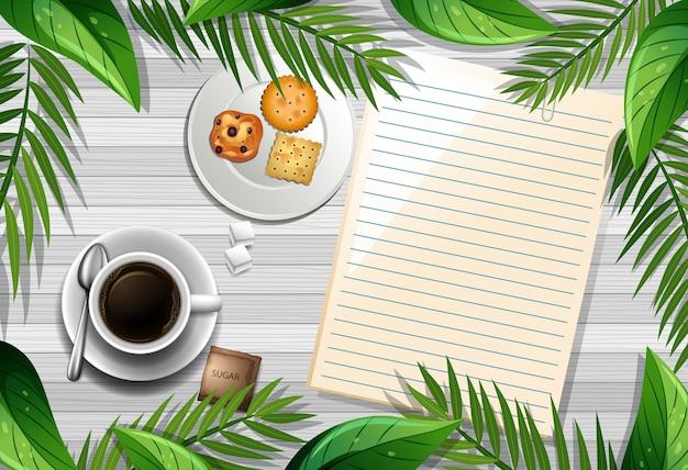 Вид сверху деревянного стола с чистым листом бумаги и чашкой кофе и элементом листьев Бесплатные векторы