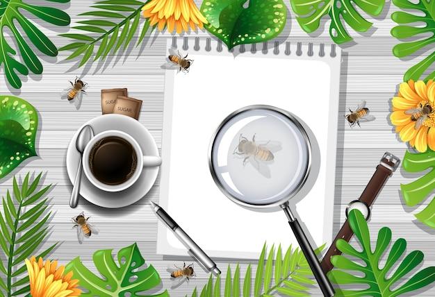 사무실 개체와 나뭇잎과 곤충 요소와 나무 테이블의 상위 뷰 무료 벡터