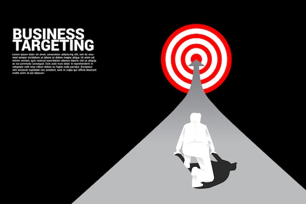 Top view silhouette of businessman ready to running on arrow to center of dartboard. Premium Vector