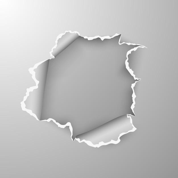 Разорванное отверстие в листе бумаги на прозрачном фоне. Premium векторы