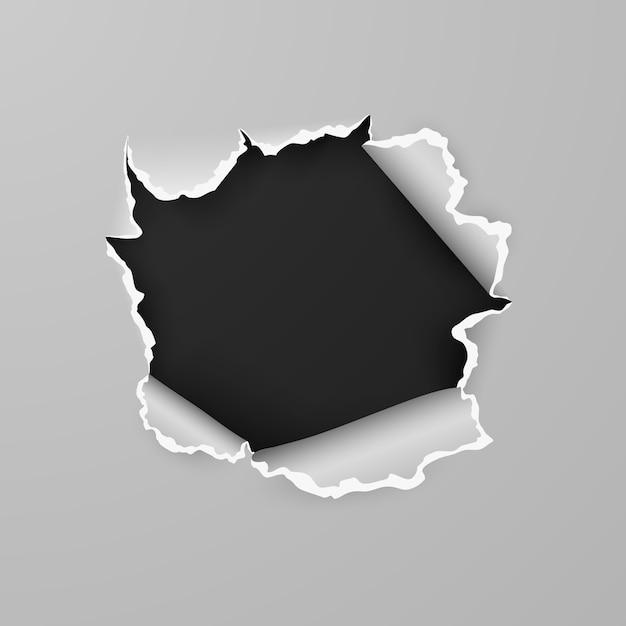 Разорванное отверстие в листе бумаги с черным фоном с пространством для текста. Premium векторы