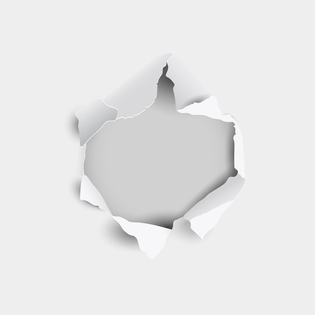 Torn hole and ripped in sheet paper on a gray background Premium Vector
