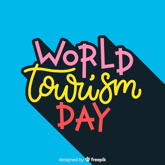 Tourism day concept with lettering Free Vector
