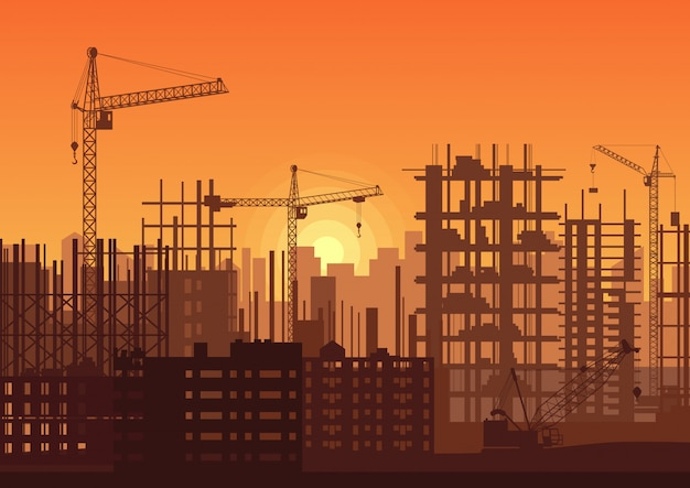 Tower cranes on construction site in sunset. Premium Vector