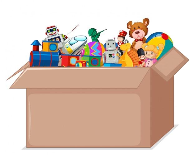 Toys in cardboard box Free Vector