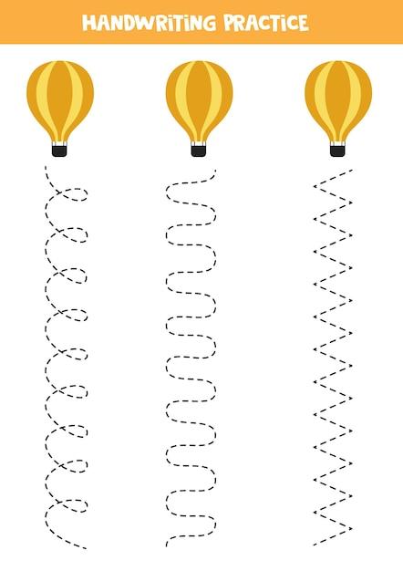 熱気球を持つ子供のためのトレースライン。子供のための手書きの練習。 Premiumベクター