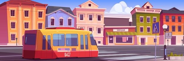 복고풍 도시 거리를 타고 트램. 빈티지 도시 풍경, 레일, 골동품 건물, 랜턴, 보행자 횡단 보도가있는 도로에 트롤리 차. 무료 벡터