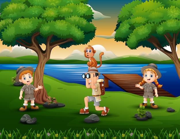 Tree children explorer in the riverside Premium Vector