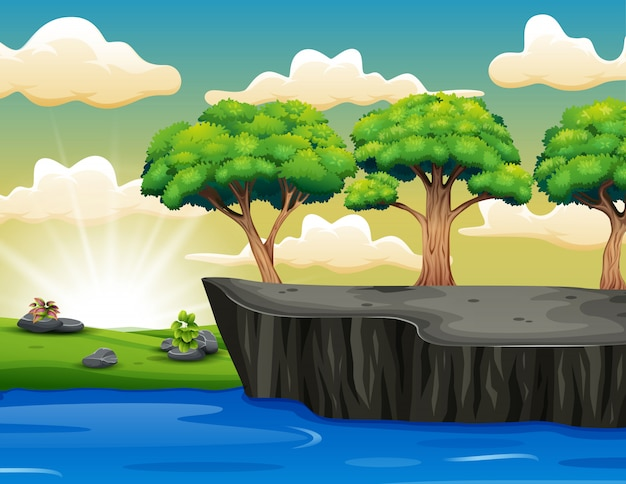 Tree on the cliff scenery with grass Premium Vector