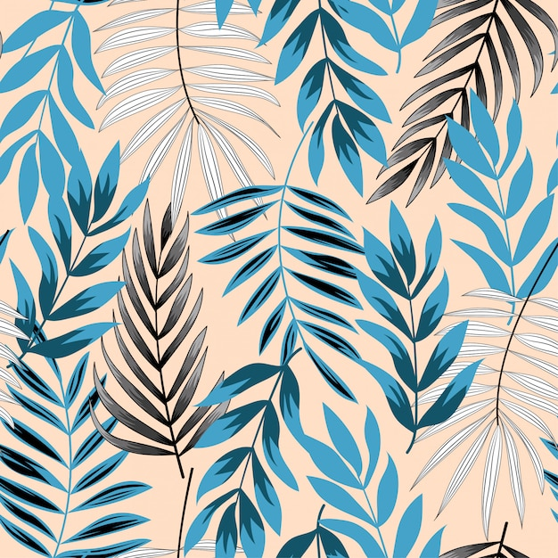 Trend abstract seamless pattern with tropical leaves Premium Vector
