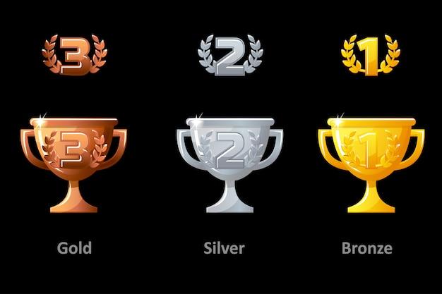 트로피 컵, 수상, 아이콘. 우승자를위한 컬렉션 골드, 실버 및 브론즈 트로피 컵 상. 로고, 라벨, 게임 앱 벡터 요소. 프리미엄 벡터